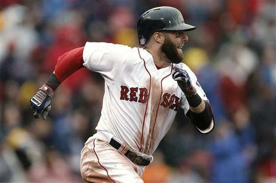 Boston Red Sox's Dustin Pedroia runs out his go ahead RBI double against the Cleveland Indians during the eighth inning of their 7-4 win in the MLB American League baseball game at Fenway Park in Boston Saturday, May 25, 2013. (AP Photo/Winslow Townson) Photo: AP / FR170221 AP