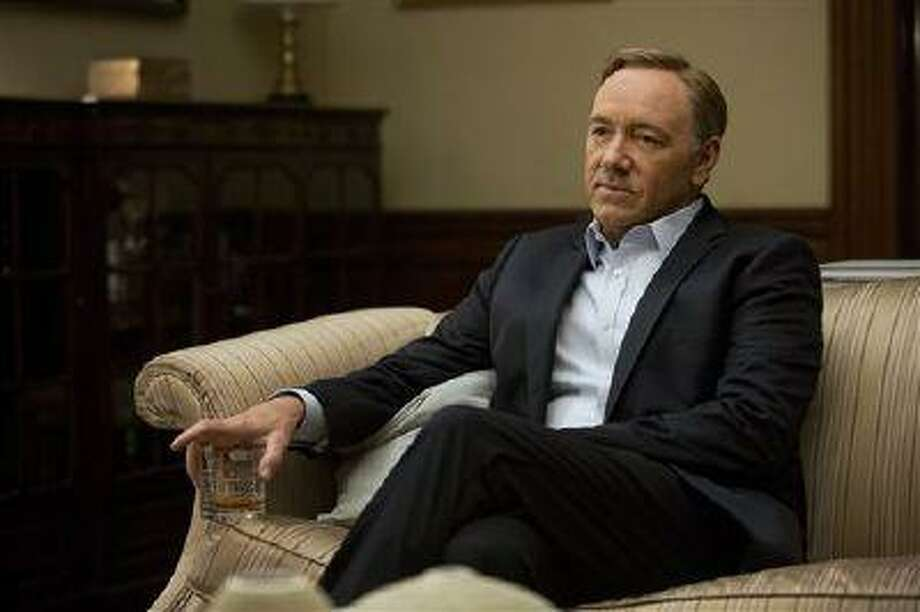 """This image released by Netflix shows Kevin Spacey in a scene from the Netflix original series, """"House of Cards,"""" an adaptation of a British classic. The program was nominated for an Emmy Award for outstanding drama series on, Thursday July 18, 2013. The Academy of Television Arts & Sciences' Emmy ceremony will be hosted by Neil Patrick Harris. It will air Sept. 22 on CBS. Photo: AP / Netflix"""