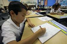 Jaeden Alvarez practices cursive writing at Cleveland K-6 School in Dayton, Ohio. In years gone by, penmanship helped distinguish the literate from the illiterate. But now, in the digital age, people are increasingly communicating by computer and smartphone. Cursive writing is not being taught in many schools as some 45 states have adopted Common Core standards, which have eliminated the teaching of cursive writing.