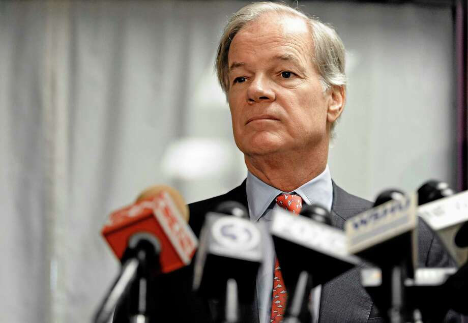 Republican Tom Foley holds a news conference to announce a committee to explore his prospects for the 2014 Connecticut governor's race in Bridgeport, Conn., Tuesday, Sept. 10, 2013. Foley said Tuesday that he is weighing another run for Connecticut governor, attacking the record of the Democrat who defeated him in 2010. (AP Photo/Jessica Hill) Photo: AP / FR125654 AP