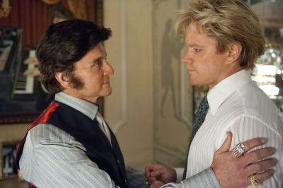 """This film image released by HBO shows Michael Douglas, left, as Liberace, and Matt Damon, as Scott Thorson in a scene from """"Behind the Candelabra."""" Nominations for the 65th annual Primetime Emmy Nominations were to be announced Thursday, July 18, 2013. (AP Photo/HBO, Claudette Barius) Photo: AP / HBO"""