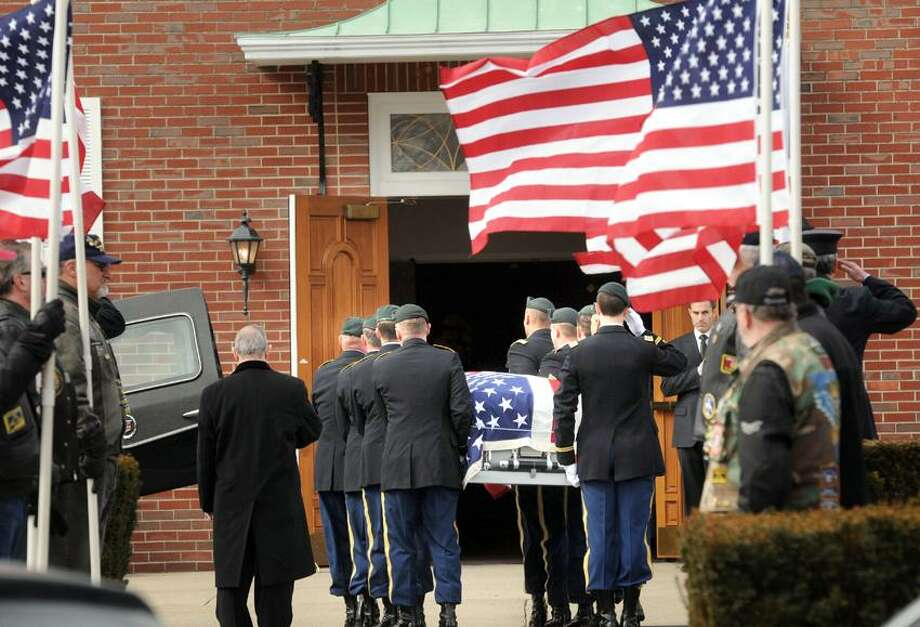 St. George Church, Guilford: The casket of Capt. Andrew Pedersen-Keel, killed in Afghanistan, was brought into the church for his funeral. Mara Lavitt/New Haven Register3/25/13