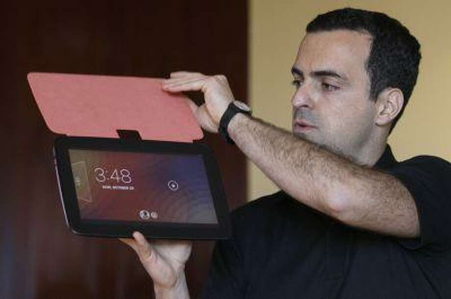 In this Monday, Monday, Oct. 29, 2012, file photo, Hugo Barra, Android at Google Director of Product Management, holds up the Nexus 10 tablet at a Google announcement in San Francisco. AP Photo/Jeff Chiu) Photo: ASSOCIATED PRESS / A20122012