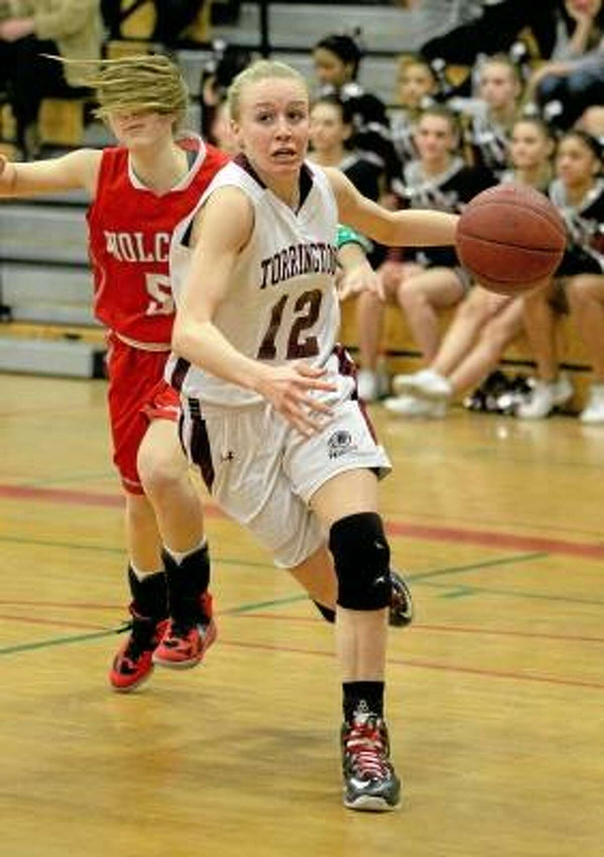 Paige Middleton (12) of the Lady Raiders drives to the hoop in her team's win over Wolcott Friday night. Photo by Marianne Killackey/Special to Register Citizen