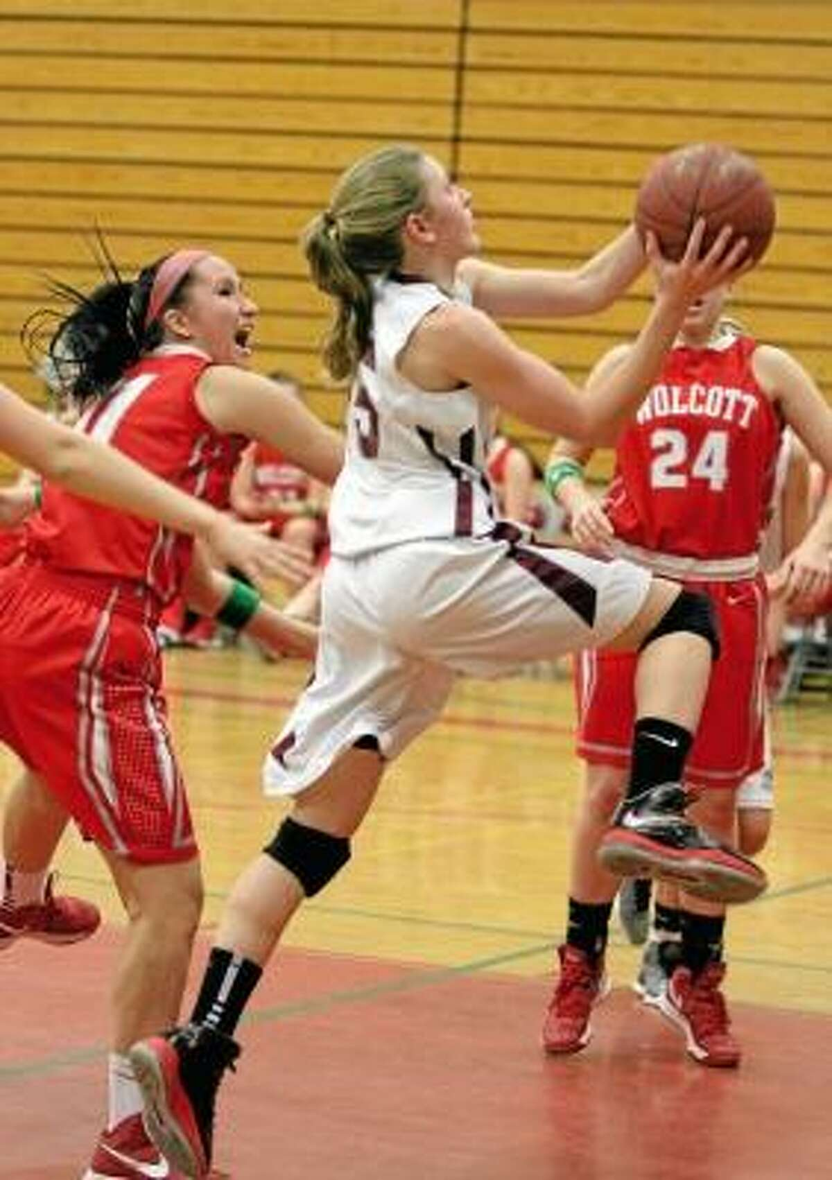Caroline Teti launches to the basket in the Lady Raiders' win over Wolcott Friday night. Photo by Marianne Killackey/Special to Register Citizen