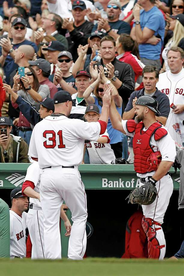Red Sox starting pitcher Jon Lester leaves to applause as he is congratulated by catcher David Ross after the top of the eighth inning of Boston's 5-1 win over the New York Yankees Saturday at Fenway Park. Photo: Winslow Townson — The Associated Press   / FR170221 AP