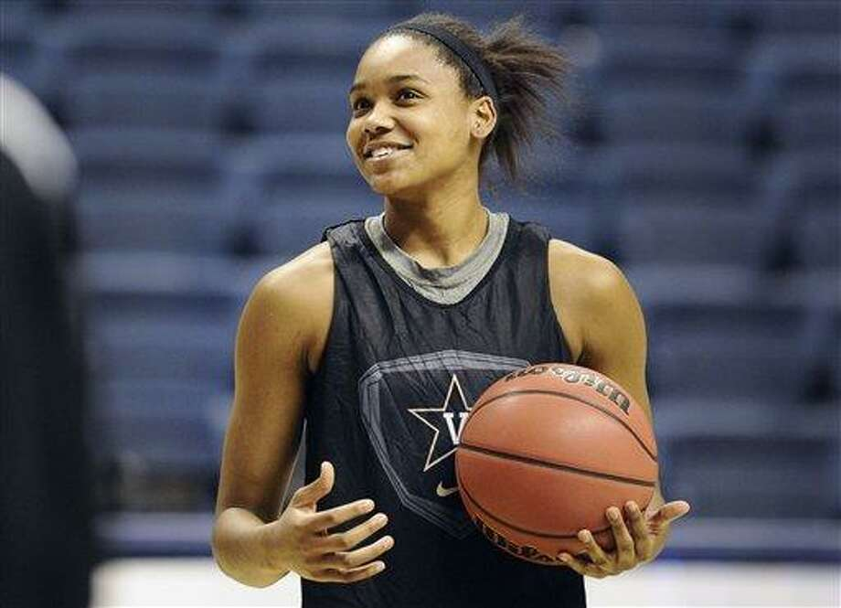 Vanderbilt's Christina Foggie smiles during practice for a first-round game in the women's NCAA college basketball tournament in Storrs, Conn., Friday, March 22, 2013. Vanderbilt will play Saint Joseph's on Saturday. (AP Photo/Jessica Hill) Photo: AP / FR125654 AP