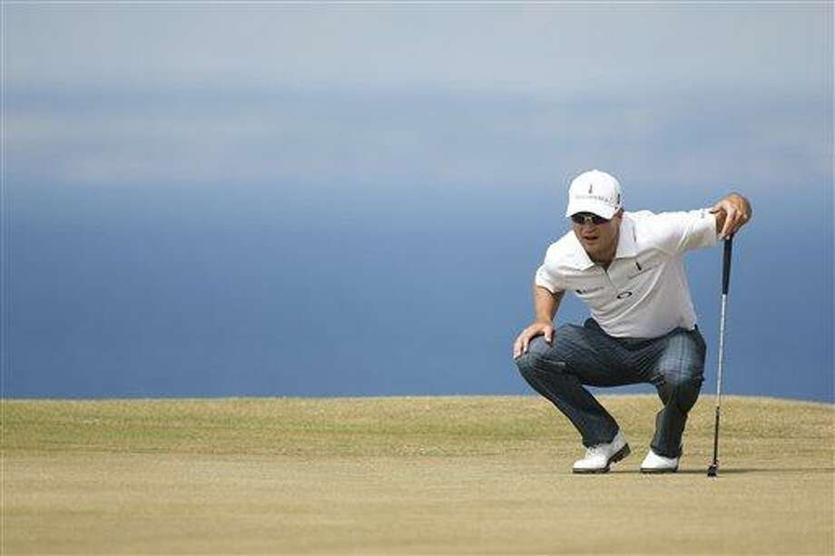 Zach Johnson of the United States lines up a putt on the 11th green during the first round of the British Open Golf Championship at Muirfield, Scotland, Thursday July 18, 2013. (AP Photo/Peter Morrison) Photo: AP / AP