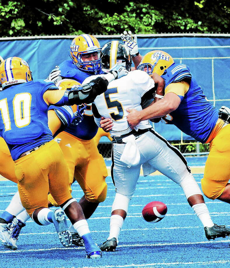 Pace quaterback Antwan Washington loses the ball as he is swarmed by the New Haven defense in the second quarter Saturday. Photo: Melanie Stengel — Register