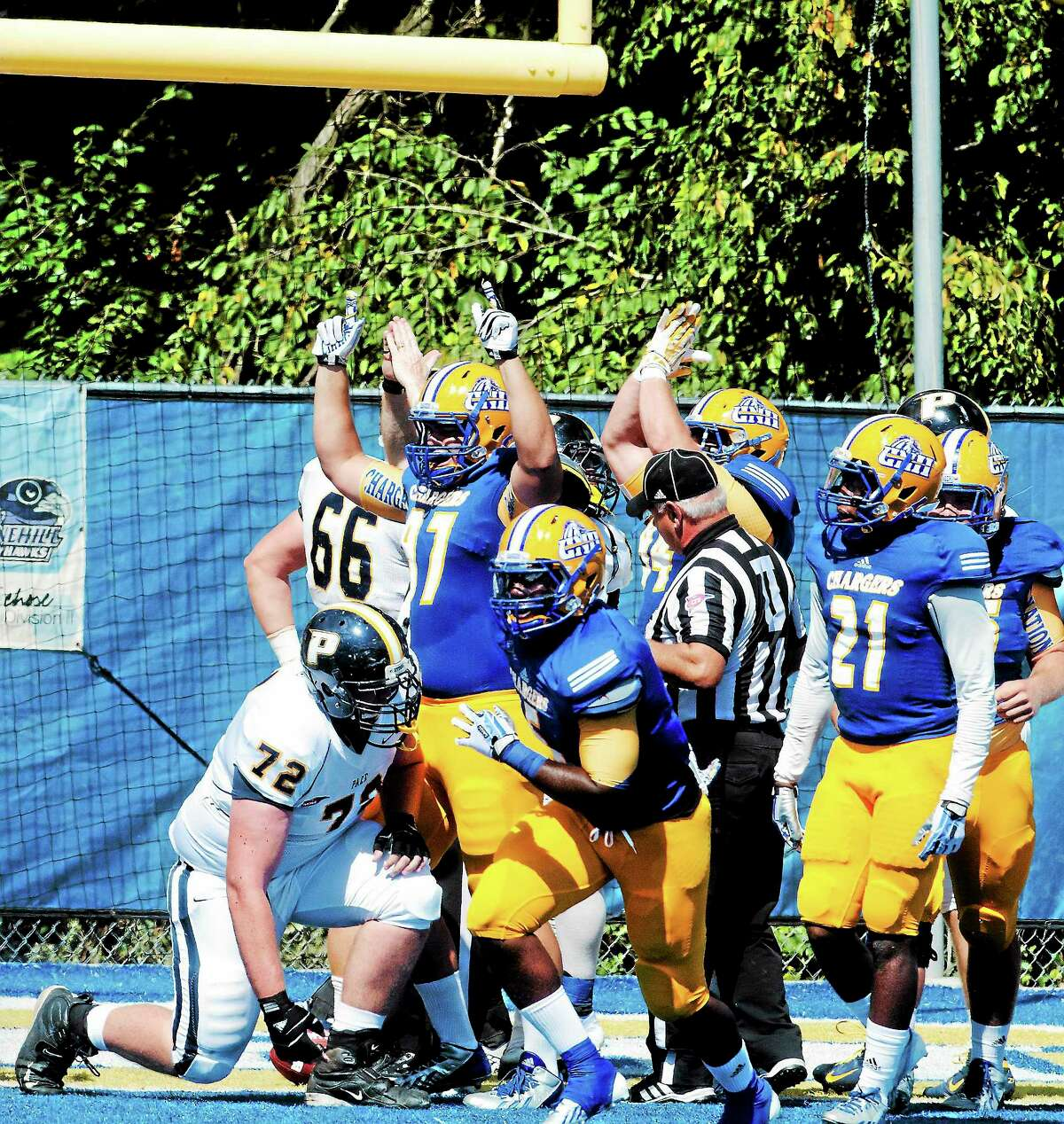 Members of the New Haven football team celebrate after recording a safety agains Pace on Saturday.
