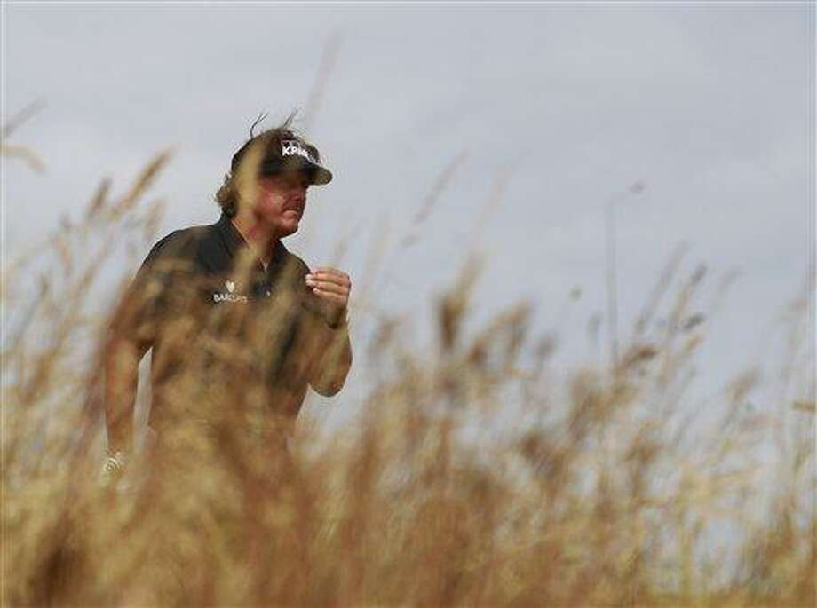 Phil Mickelson of the United States prepares to play off the 8th tee during the first round of the British Open Golf Championship at Muirfield, Scotland, Thursday July 18, 2013. (AP Photo/Peter Morrison) Photo: AP / AP