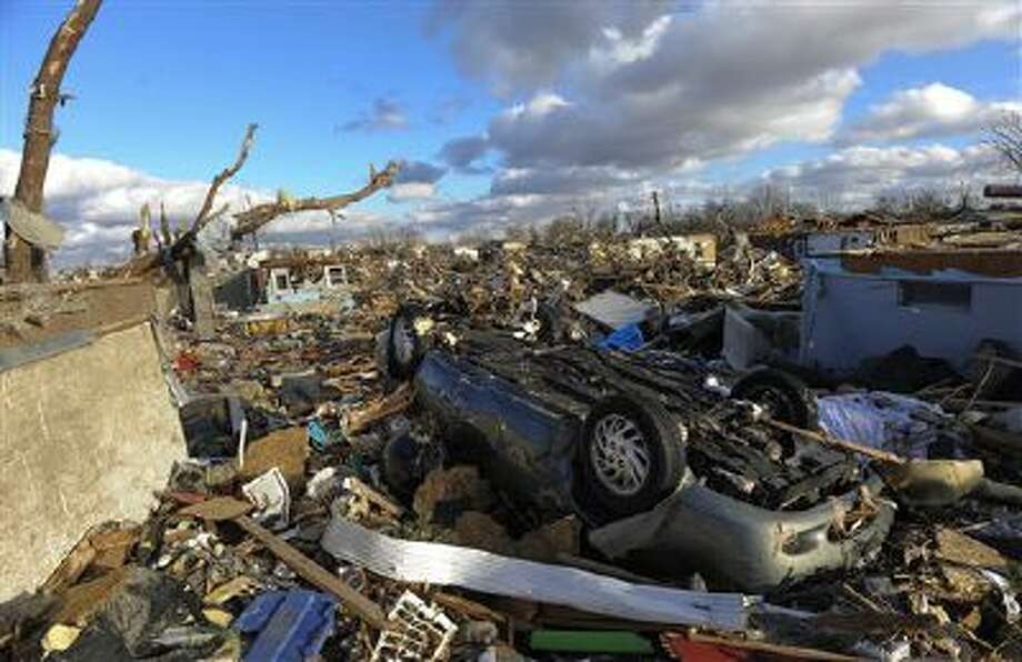 A neighborhood in the Devonshire subdivision of Washington, Ill., is left in ruins after a tornado tore through the northern part of the town on Sunday, Nov. 17, 2013. (AP Photo/Peoria Journal Star, Ron Johnson) Photo: AP / Journal Star