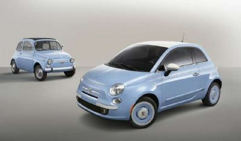 """2014 Fiat 500 1957 Edition. The car is available in three classic exterior colors, and features a 1957-era wheel design, Bianco-painted roof and vintage """"FIAT"""" emblems."""