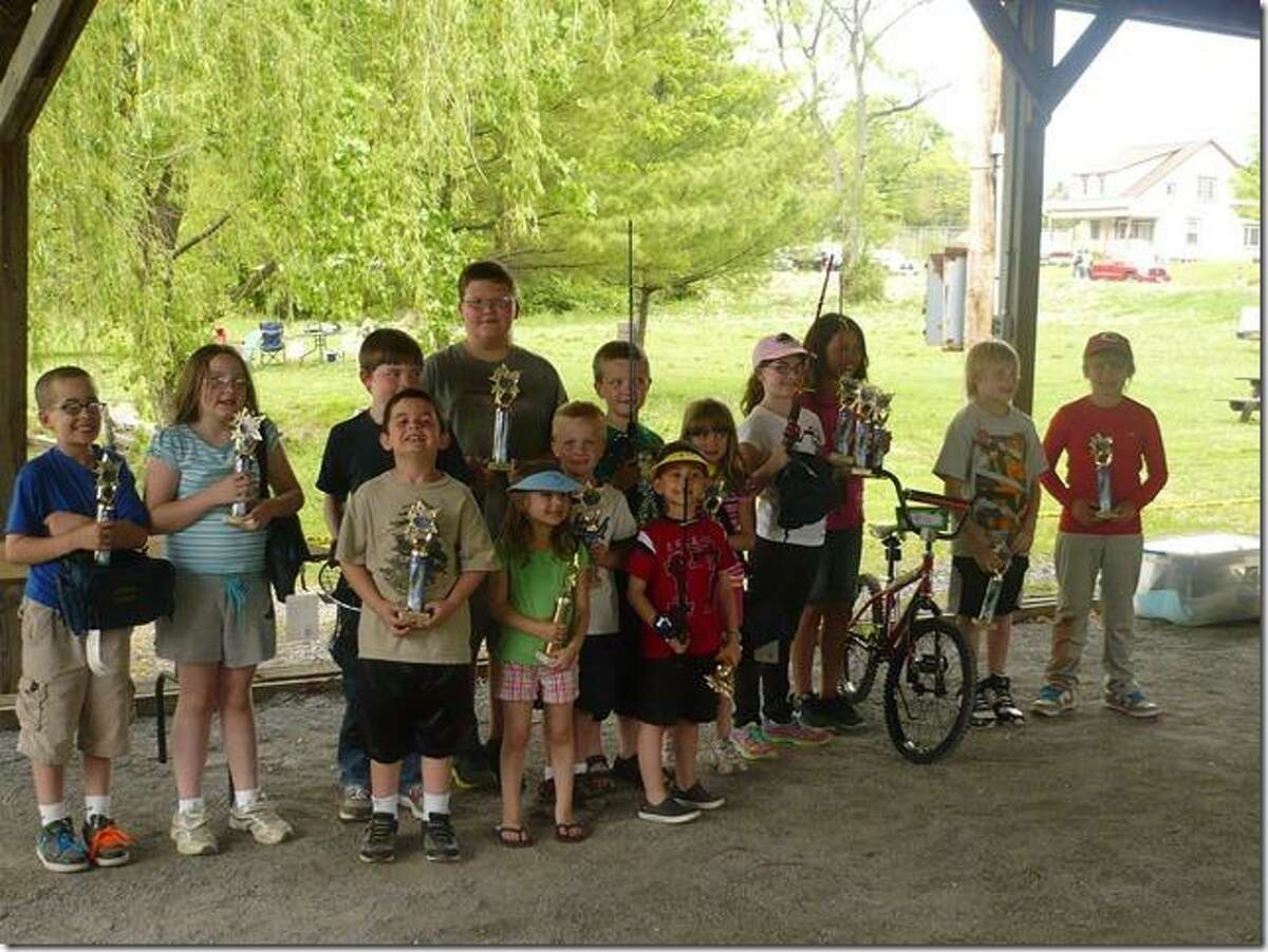 Photo Courtesy Sherrill Fishing Derby Participants of the 2013 Sherrill Kids Fishing Derby pose with their trophies.