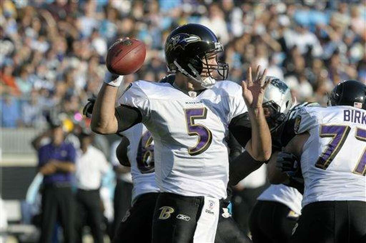 Baltimore Ravens' Joe Flacco (5) throws a pass during an NFL football game against the Carolina Panthers in Charlotte, N.C., Sunday, Nov. 21, 2010. (AP Photo/Mike McCarn)