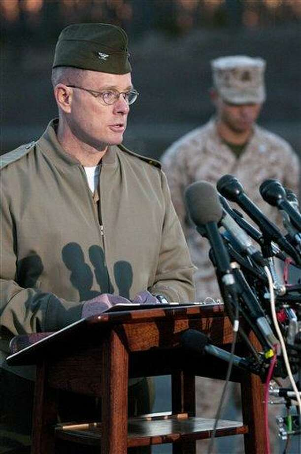 Col. David W. Maxwell, commander of Marine Corps Base Quantico, holds a news conference at the National Museum of the Marine Corps in Triangle, Va. on Friday, March 22, 2013.   A Marine killed a male and female colleague in a shooting before killing himself, officials said early Friday. Authorities were called to the scene at Marine Corps Base Quantico around 10:30 p.m. Thursday, where they found one Marine dead at a barracks, base according to Maxwell.  Authorities later found a second victim dead, along with the body of the suspected gunman, who died of self-inflicted gunshot wound.  (AP Photo/Marine Corps Times, Mike Morones) Photo: AP / Marine Corps Times