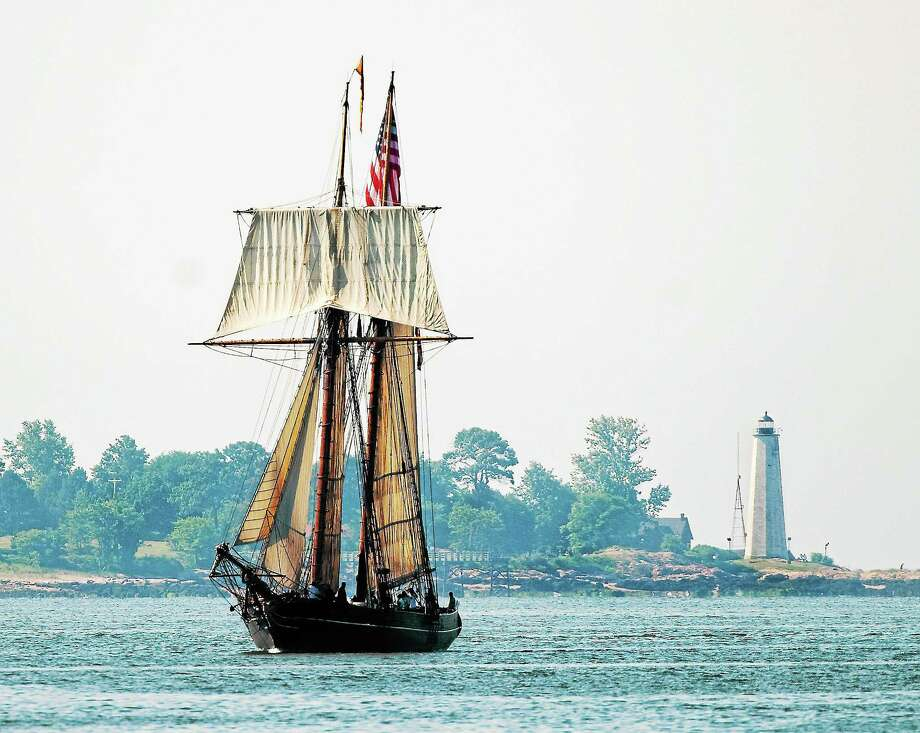 New Haven-- The Amistad makes its way into New Haven Harbor with the New Haven Lighthouse in the distance in this 2008 file photo, Photo-Peter Casolino Photo: Journal Register Co.