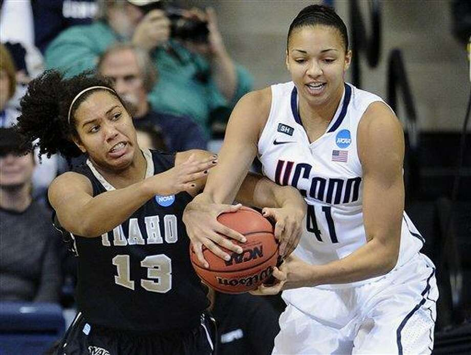 Idaho's Ali Forde, left, and Connecticut's Kiah Stokes fight for a rebound in the first half of a first-round game in the women's NCAA college basketball tournament in Storrs, Conn., Saturday, March 23, 2013. (AP Photo/Jessica Hill) Photo: ASSOCIATED PRESS / A2013