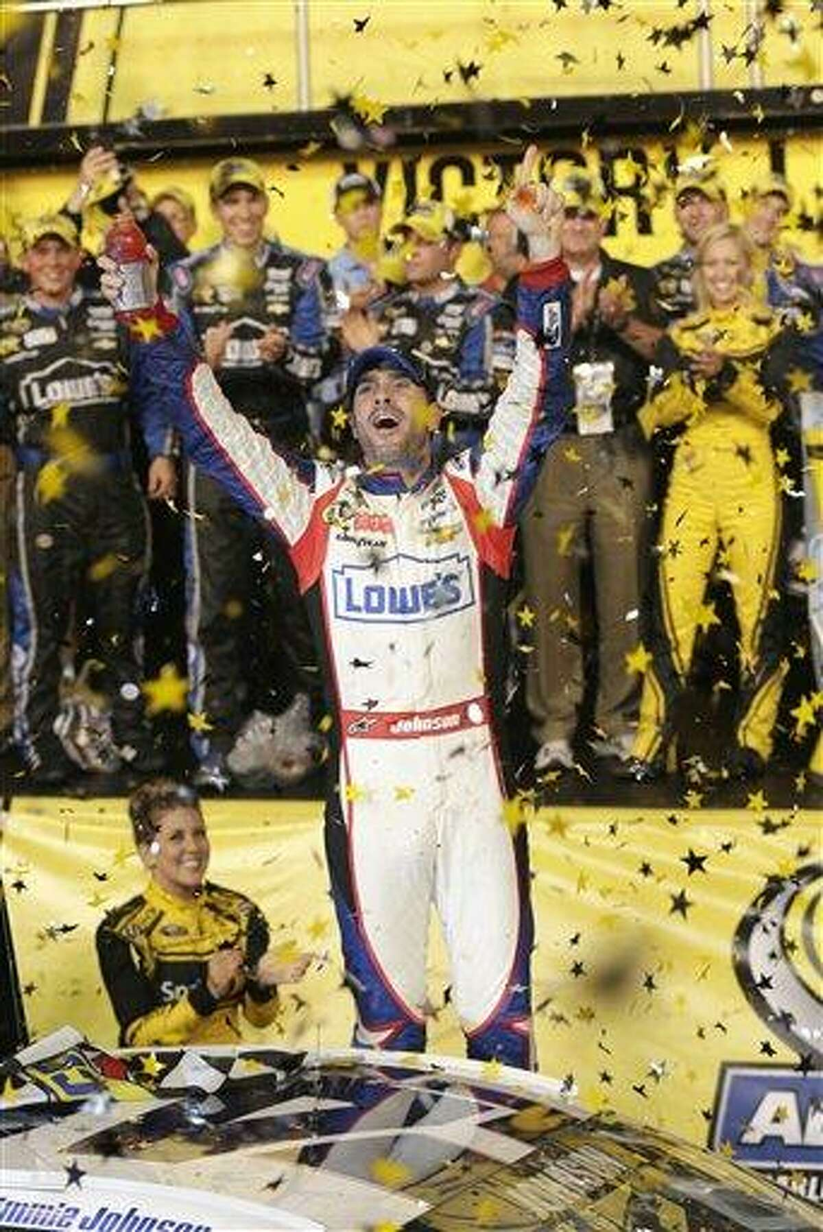 Jimmie Johnson celebrates after winning the NASCAR All-Star auto race at Charlotte Motor Speedway in Concord, N.C., Saturday, May 18, 2013. (AP Photo/Chuck Burton)