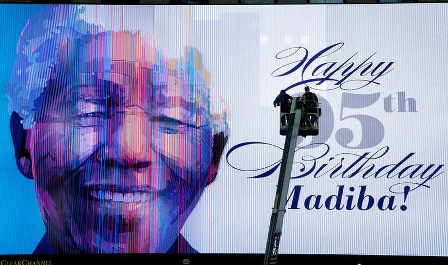 An electronic billboard announces Nelson Mandela's 95th birthday in New York's Times Square, Thursday, July 18, 2013. South Africa celebrated Nelson Mandela's 95th birthday on Thursday, a milestone capped by news that the former president's health was improving after fears that he was close to death during ongoing hospital treatment. (AP Photo/Mark Lennihan) Photo: AP / AP