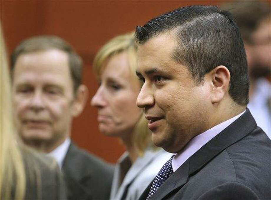 George Zimmerman leaves court with his family after Zimmerman's not guilty verdict was read in Seminole Circuit Court in Sanford, Fla. on Saturday, July 13, 2013. Jurors found Zimmerman not guilty of second-degree murder in the fatal shooting of 17-year-old Trayvon Martin in Sanford, Fla. (AP Photo/Joe Burbank, Pool) Photo: AP / Orlando Sentinel POOL