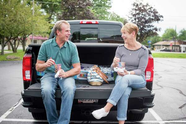 Jeff Schroeder, 59 and his wife Kathy Schroeder, 64 enjoy ice cream in the back of their pickup truck in a parking lot in Canfield, Ohio.