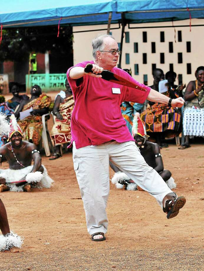 CONTRIBUTED PHOTOPaul Stetson of North Haven learns a Ghanaian dance, while his hosts look on in amusement. Photo: Journal Register Co.
