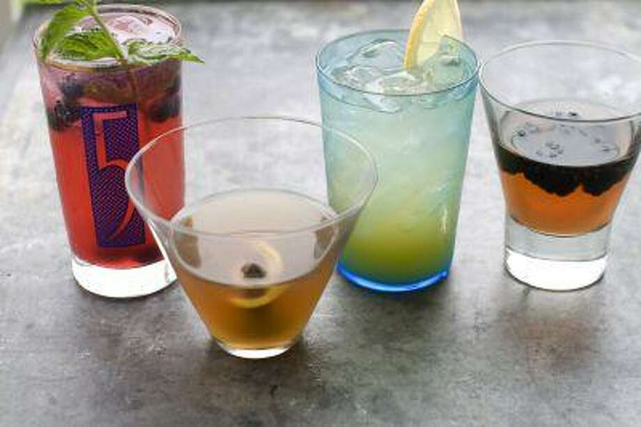 In this image taken on June 10, 2013, from left, Blue Rickey Spritzer, Apple Cobbler, Full Moon Lemonade, and Low-Hanging Fruit drinks are shown in Concord, N.H. (AP Photo/Matthew Mead) Photo: AP / FR170582
