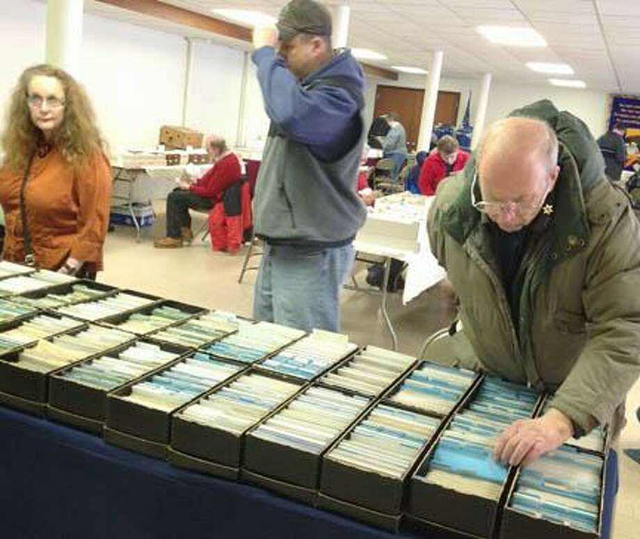 John Haeger @OneidaPhoto on Twitter/Oneida Daily Dispatch Collector look through postcards during the annual Central New York Postcard Club's show on March 23in Oneida. Photo: Oneida Daily Dispatch / Oneida Daily Dispatch
