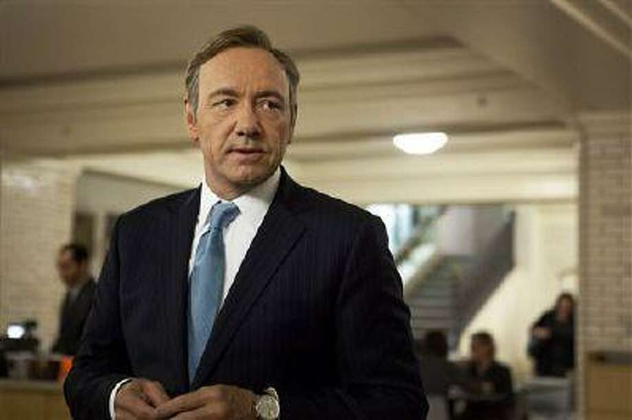"""This image released by Netflix shows Kevin Spacey as U.S. Congressman Frank Underwood in a scene from the Netflix original series, """"House of Cards."""" If Netflix's """"House of Cards"""" and """"Arrested Development"""" become the first online shows to reap Emmy nominations Thursday, July 18, it will be a watershed moment for programs that don't need television sets to make a splash. (AP Photo/Netflix, Melinda Sue Gordon) Photo: AP / Netflix"""