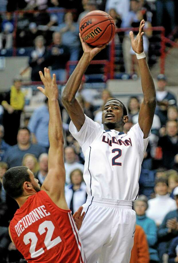 UConn's DeAndre Daniels (2) goes up for a shot while being guarded by Boston University's Nathan Dieudonne during the first half Sunday in Storrs. Photo: Fred Beckham — The Associated Press   / FR153656 AP