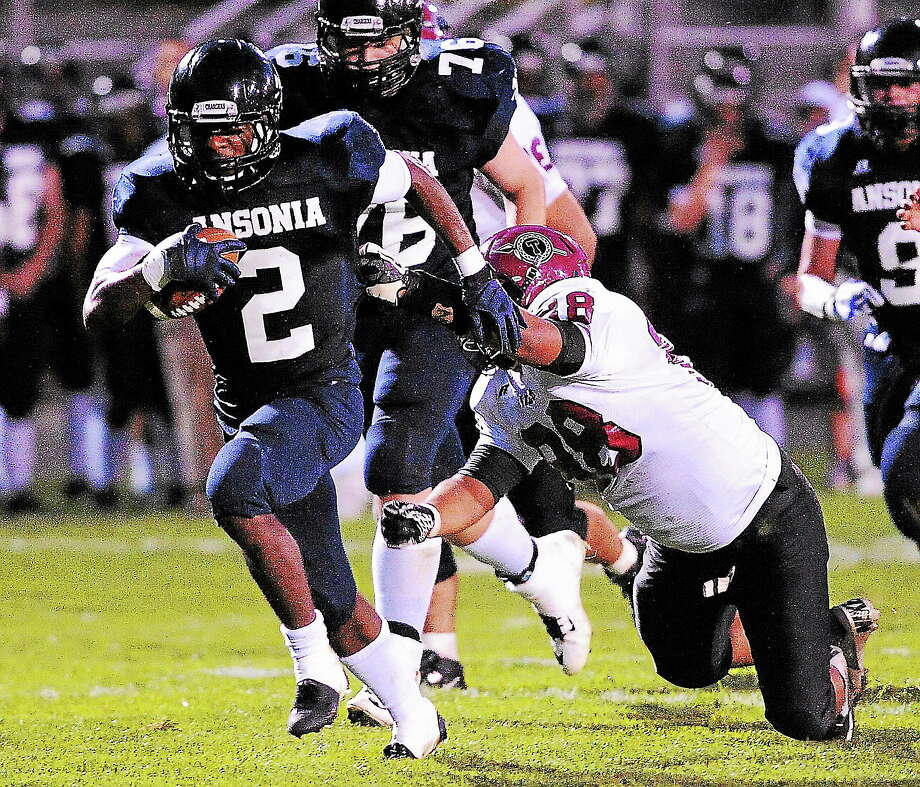 Ansonia's Arkeel Newsome heads toward the end zone on his way to a record-breaking touchdown against Torrington in the first quarter on Friday night. Photo: Peter Casolino — Register