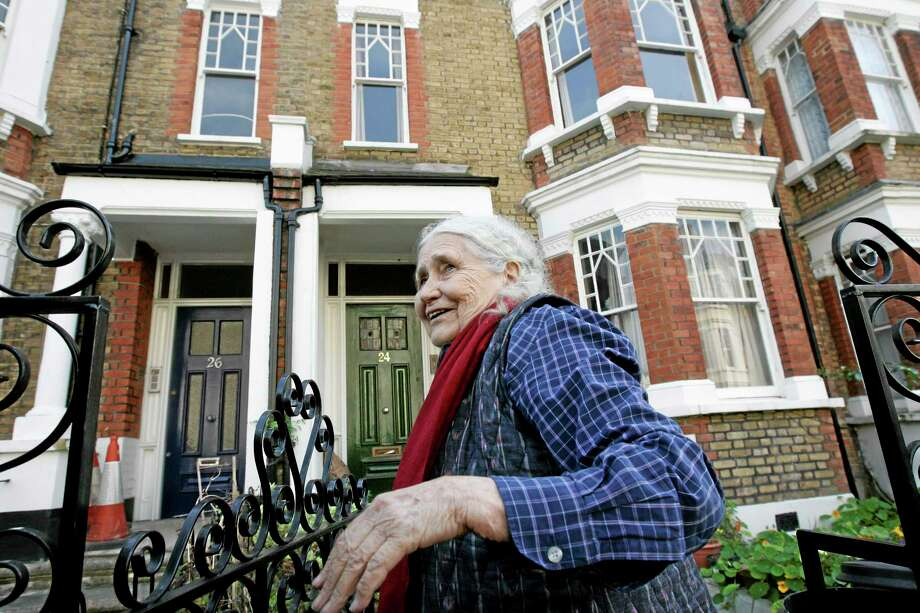 """FILE - In this Thursday, Oct. 11, 2007 file photo, British writer Doris Lessing, winner of the 2007 Nobel Prize in literature, smiles as she talks to members of the media, shortly after the announcement of the award, outside her home in north London. Doris Lessing, the free-thinking, world-traveling, often-polarizing writer of """"The Golden Notebook"""" and dozens of other novels that reflected her own improbable journey across the former British empire, has died, early Sunday, Nov. 17, 2013.  She was 94. The author of more than 50 works of fiction, nonfiction and poetry, Lessing explored topics ranging from colonial Africa to dystopian Britain, from the mystery of being female to the unknown worlds of science fiction.  (AP Photo/Lefteris Pitarakis, File) Photo: AP / AP"""
