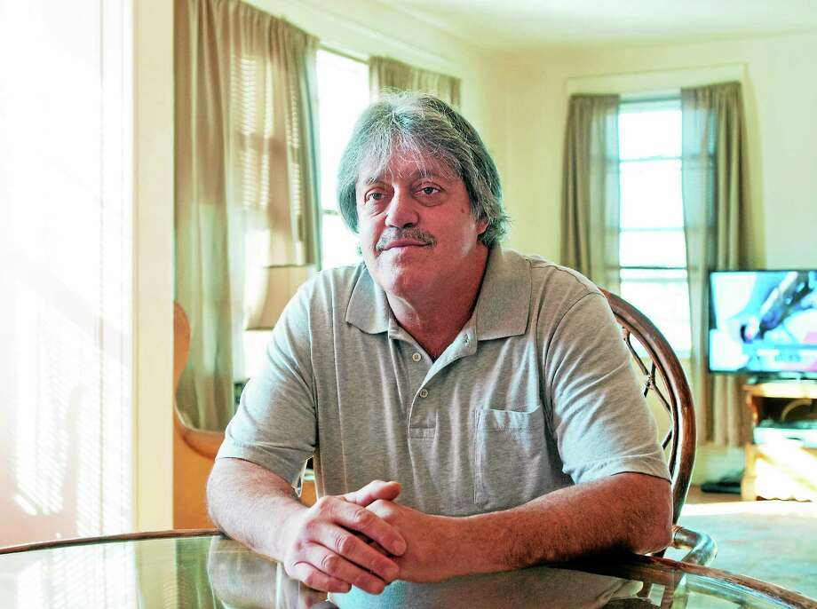 Ron Harrington is happy to be in his West Haven apartment with help from the VA, as he was homeless a year ago. Photo: Peter Casolino — New Haven Register