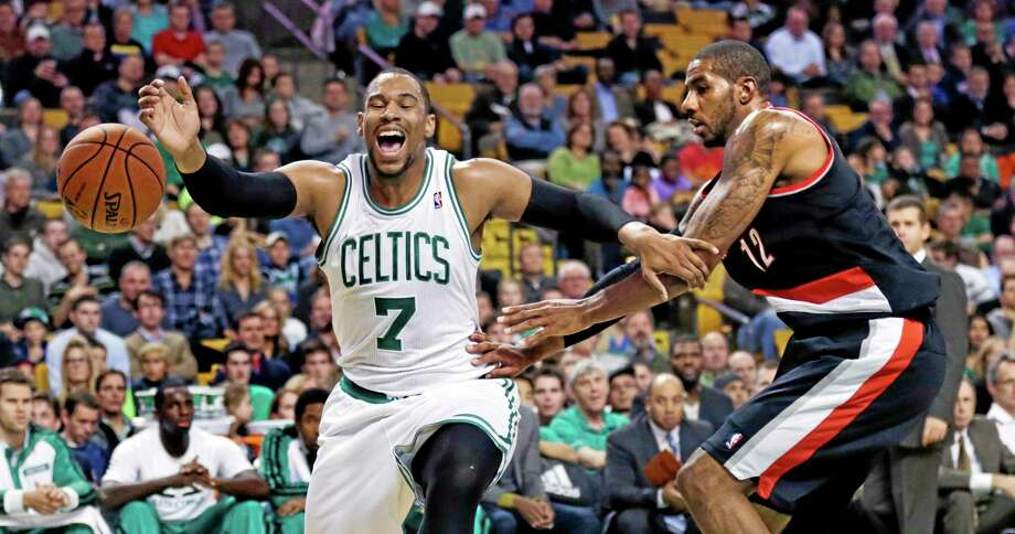 Celtics forward Jared Sullinger loses control of the ball as he is pressured by Portland Trail Blazers forward LaMarcus Aldridge during the first quarter on Friday in Boston. Photo: Charles Krupa — The Associated Press   / AP