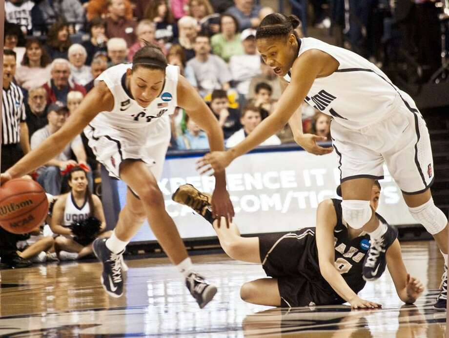 "0323-Big East- UCONN vs. Idaho Basketball 1st Half Action----UCONN's Bria Hartley (L) and Moriah Jefferson  steals the ball mid court from Idaho's Addie Schivo.  Photos by Melanie  Stengel  <a href=""mailto:mstengel@nhregister.com"">mstengel@nhregister.com</a>"