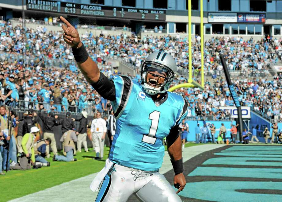 Panthers quarterback Cam Newton celebrates after a touchdown earlier this season. Photo: Mike McCarn — The Associated Press   / FR34342 AP