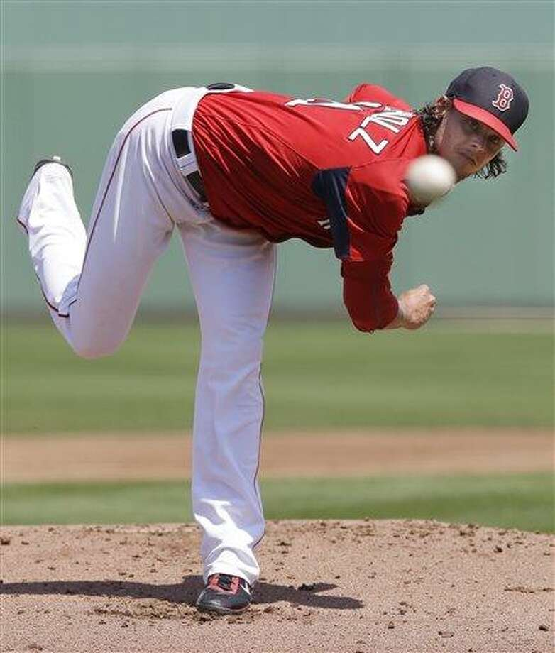 Boston Red Sox starting pitcher Clay Buchholz delivers to the Pittsburgh Pirates in the first inning of an exhibition spring training baseball game in Fort Myers, Fla., Saturday, March 23, 2013. (AP Photo/Elise Amendola) Photo: AP / AP