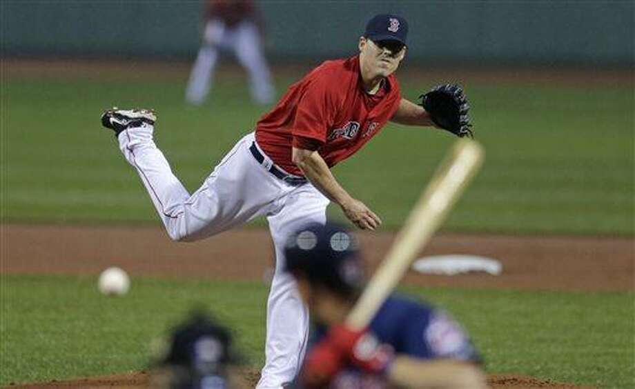Boston Red Sox starting pitcher John Lackey delivers during the first inning of a baseball game against the Cleveland Indians at Fenway Park in Boston, Friday, May 24, 2013. (AP Photo/Charles Krupa) Photo: AP / AP