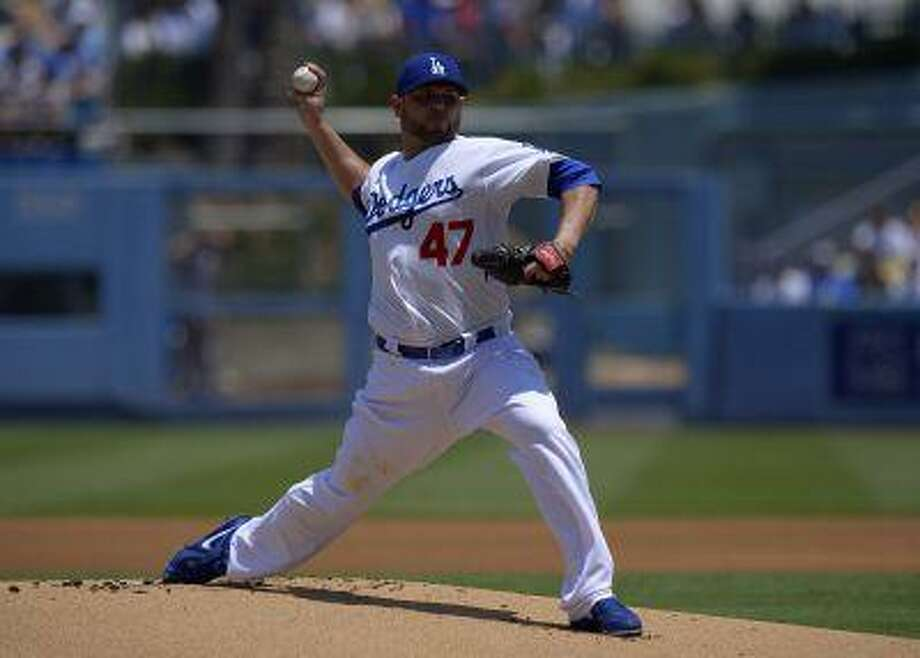 Los Angeles Dodgers starting pitcher Ricky Nolasco throws to the plate during the first inning of their baseball game against the Colorado Rockies, Sunday, July 14, 2013, in Los Angeles. Photo: AP / AP