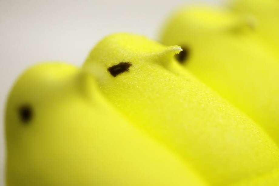 In this Wednesday, Feb. 13, 2013 photo, displayed are Peeps at the Just Born factory in Bethlehem, Pa. With the storied candy brand celebrating its 60th anniversary this year, a quirky new TV ad campaign talks about all the things people do with their Peeps. (AP Photo/Matt Rourke) Photo: AP / AP