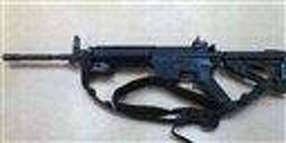 This image provided by the Fontana Unified School District Police shows a Colt LE6940 semiautomatic rifle, one of 14 purchased by the Fontana Unified School District to help provide security for the school, in California. The weapons, which cost $1,000 each, are high-powered weapons that are accurate at longer range and can pierce body armor.   (AP Photo/FUSD Police) Photo: AP / Fontana Unified School District Police