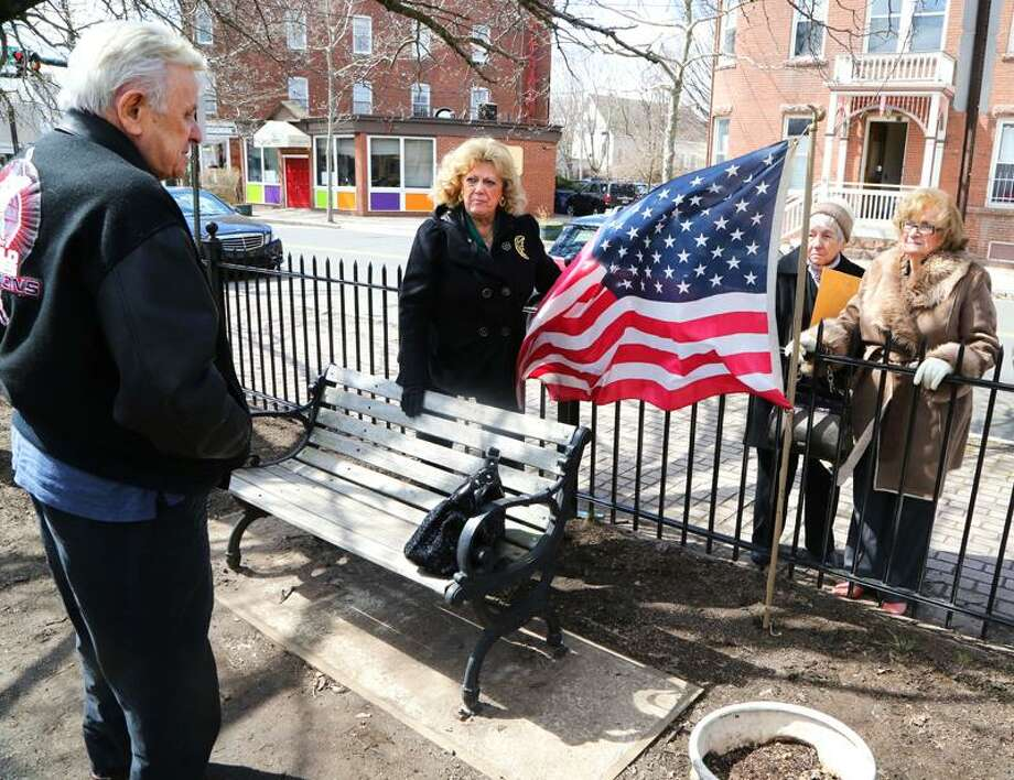 NEW HAVEN- From left, World War II veteran Sal Nero of Branford, Marie Notarino of Branford, Anne Wiel of Branford and Adele Nero of Branford stand where a WWII memorial once was, but went missing in Triangle Park in New Haven.                 Chynna Davis/For the Register