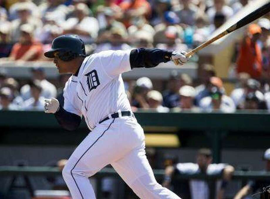 Detroit Tigers' Miguel Cabrera drives in a run against the Tampa Bay Rays during the first inning of their MLB spring training baseball game in Lakeland, Florida March 19, 2013. REUTERS/Scott Audette (UNITED STATES - Tags: SPORT BASEBALL) Photo: REUTERS / X01879