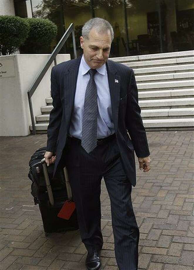 Former FBI Director Louis Freeh leaves Federal Court after meeting with U.S. District Judge Carl Barbier in New Orleans, Tuesday, July 2, 2013. Barbier appointed Freeh to investigate alleged misconduct by a lawyer who helped run BP's multibillion-dollar settlement fund. (AP Photo/Gerald Herbert) Photo: AP / AP