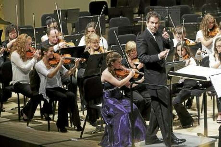 Sandy Aldieri/Special to the Press Conductor Edward Cumming gives a thumbs up for the audience participation during the strings performance of Middletown High Goes to the Symphony on Thursday.