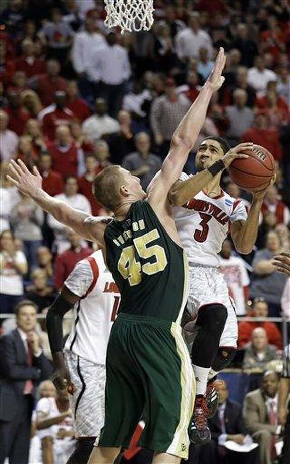 Louisville guard Peyton Siva (3) drives against Colorado State forward/center Colton Iverson (45) in the second half of a third-round NCAA college basketball tournament game Saturday, March 23, 2013, in Lexington, Ky. Louisville won 82-56.  (AP Photo/John Bazemore) Photo: ASSOCIATED PRESS / AP2013