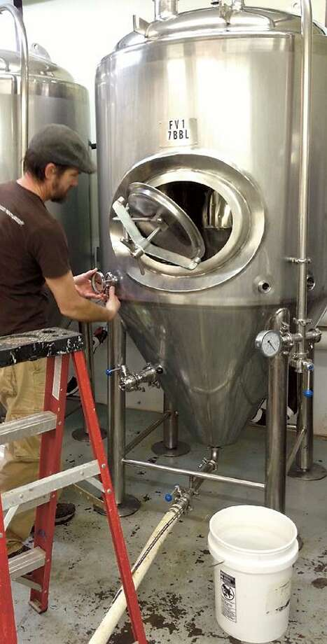 "Dispatch Staff Photos by JOHN HAEGER <a href=""http://twitter.com/oneidaphoto"">twitter.com/oneidaphoto</a> Marc Fishel of Good Nature Brewing prepares a fermenter at the craft brewery in Hamilton."