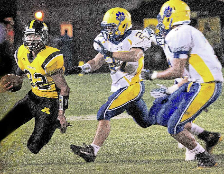 Amity's David Buono eludes Seymour for a first down during the second half of Amity's 24-21 win Wednesday. Photo: Melanie Stengel — The Register