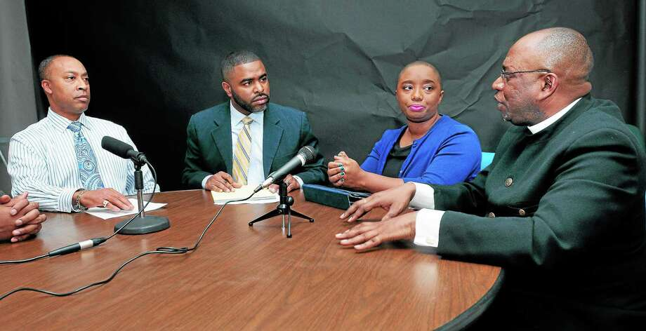 New Haven Register Community Engagement Editor Shahid Abdul-Karim, second from left, talks Project Longevity program managers, from left, Charles Grady of Bridgeport, Tiana Hercules of Hartford and the Rev. William Mathis of New Haven, right. Photo: Arnold Gold — New Haven Register